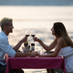 Happy couple on summer evening having romantic dinner outdoor - PhotoDune Item for Sale