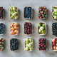 Flat-lay of fresh fruits and berries over grey concrete background - PhotoDune Item for Sale