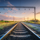 Railway station and beautiful sky at sunset. Railroad in summer - PhotoDune Item for Sale