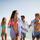 Group of happy friends on vacation having fun on beach in summer - PhotoDune Item for Sale