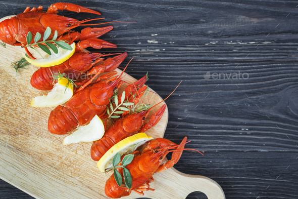 Close-up of boiled crawfish with lemon and green - Stock Photo - Images