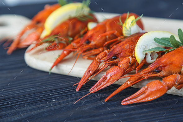 Close-up of boiled crawfish with lemon and herb - Stock Photo - Images