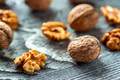 Walnuts and kernels on wooden backgound - PhotoDune Item for Sale