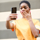 Young black woman taking selfie photographs with funny expression outdoors - PhotoDune Item for Sale