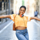Young black woman is dancing on the street in Summer. Girl traveling alone - PhotoDune Item for Sale