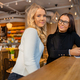 Two Urban Female Friends Looking At Camera in Cafe - PhotoDune Item for Sale
