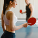 Man and woman playing ping pong indoors - PhotoDune Item for Sale
