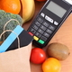 Payment terminal, contactless credit card, paper shopping bag and fruits with vegetables - PhotoDune Item for Sale
