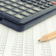 Calculator and pencil on spreadsheet. Business concept - PhotoDune Item for Sale