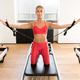 Woman doing pilates arm work with straps - PhotoDune Item for Sale