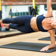 Woman doing suspended elbow side plank with trx - PhotoDune Item for Sale