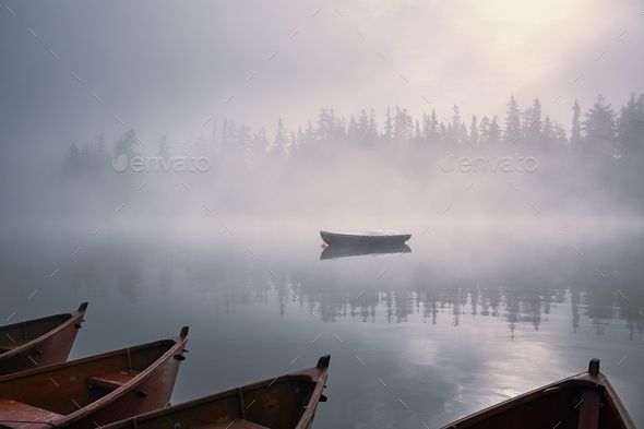 Boats in mysterious fog - Stock Photo - Images