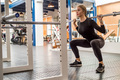 Young woman does barbell squats in modern gym - PhotoDune Item for Sale