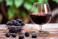 Close up fresh mulberries fruit in bowl and wine in glass - PhotoDune Item for Sale