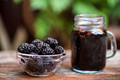 Close up fresh mulberries fruit in bowl and juice in jar - PhotoDune Item for Sale