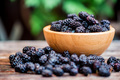 Close up fresh mulberries fruit in wooden bowl on table - PhotoDune Item for Sale
