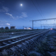 Railroad and blue sky with moon and clouds at night - PhotoDune Item for Sale