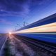 High speed passenger train in motion on the railroad at night - PhotoDune Item for Sale