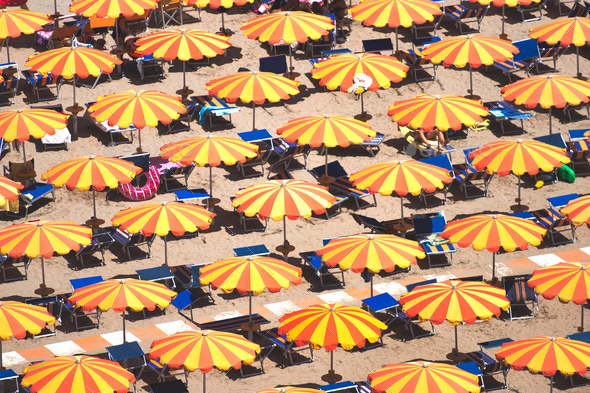 Detail of umbrellas on the beach on the Romagna coast in Italy - Stock Photo - Images