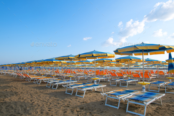 Umbrellas and sun loungers on the beach in the Adriatic. Romagna - Stock Photo - Images
