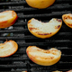 Grilled peach on black gas grill. Grilled dessert. - PhotoDune Item for Sale