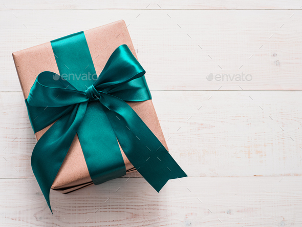 Gift box in craft paper and satin ribbon - Stock Photo - Images