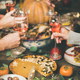 Friends clinking glasses with rose wine at festive Christmas table - PhotoDune Item for Sale