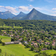 Scenic view of mountains and scattering houses from Menthon castle in Haute-Savoie - PhotoDune Item for Sale