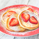 Portion of ricotta fritters with fresh strawberries - PhotoDune Item for Sale