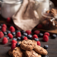 Close up of delicious pile of chocolate cookies with dark chocolate and fresh raspberries - PhotoDune Item for Sale
