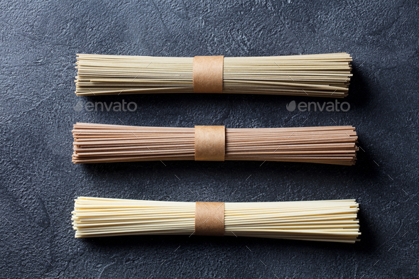Assortment of Asian Soba, Green Tea and Egg Noodles. Slate Background. Top View. - Stock Photo - Images