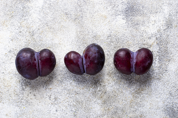 Ugly plums. Abnormal organic fruit - Stock Photo - Images