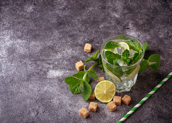 Summer drink mojito with rum, mint, ice and lime - Stock Photo - Images
