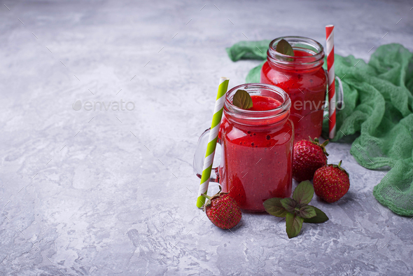Strawberry smoothie in glass jars - Stock Photo - Images