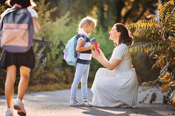 Parent and pupils go to school - Stock Photo - Images