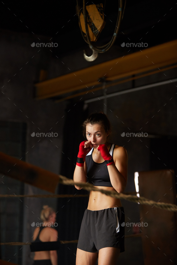 Tough Young Woman Boxing in Ring - Stock Photo - Images