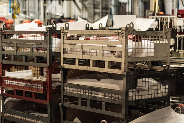 Boxes with spare parts at combine factory - Stock Photo - Images