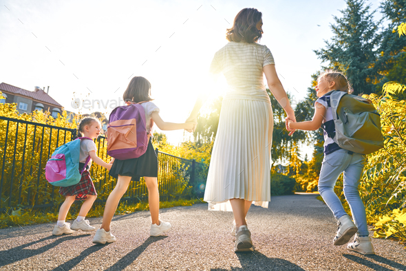 Parent and pupils are going to school - Stock Photo - Images
