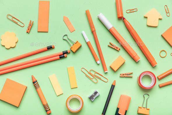 Flat lay of office, school stationery on green background - Stock Photo - Images