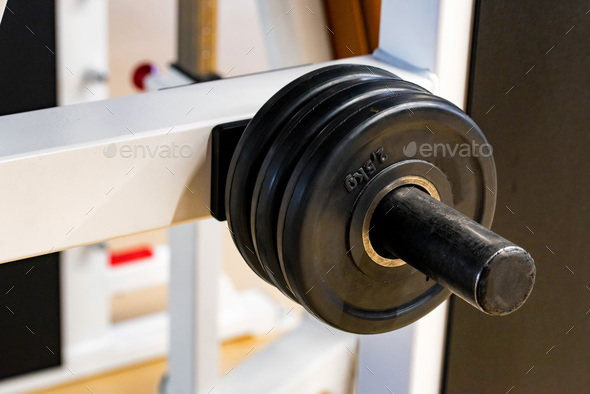 Fitness dumbbell and barbell weight plates in gym close - Stock Photo - Images