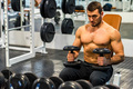 Close-up of male athlete trainig at gym - PhotoDune Item for Sale