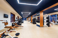 New fitness machines in modern gym interior - PhotoDune Item for Sale