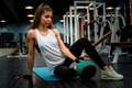 Young fitness girl does abs exercises with a ball in gym - PhotoDune Item for Sale