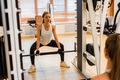 Fit young woman doing deadlift exercise in the smith machine - PhotoDune Item for Sale
