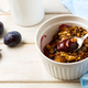 Plum granola in the white baking ceramic form - PhotoDune Item for Sale