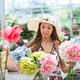 Young woman choosing a bunch of fresh hydrangeas - PhotoDune Item for Sale