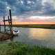 Sunrise over a boat moored to an old wooden jetty at Thornham - PhotoDune Item for Sale