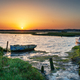 Summer sunrise over old boats on the shores of Holes Bay - PhotoDune Item for Sale