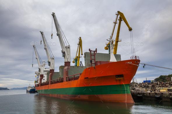 Cargo ship in the port. Kamchatka Peninsula. - Stock Photo - Images