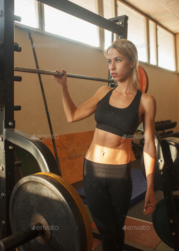 young woman fitness training in brutal gym interior - Stock Photo - Images
